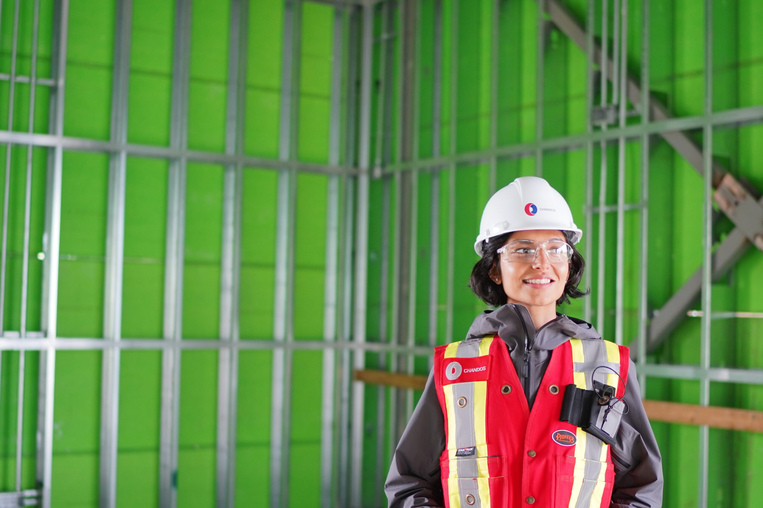 Chandos Construction is a purpose business committed to social procurement as a powerful tool to shape healthy communities and create impact. This includes diversity in their supply chain and hiring as pictured by the female construction worker in the image.